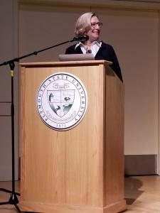 Speaker Sign on a podium