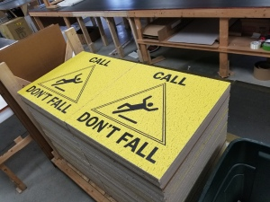ceiling tiles with call don't fall message