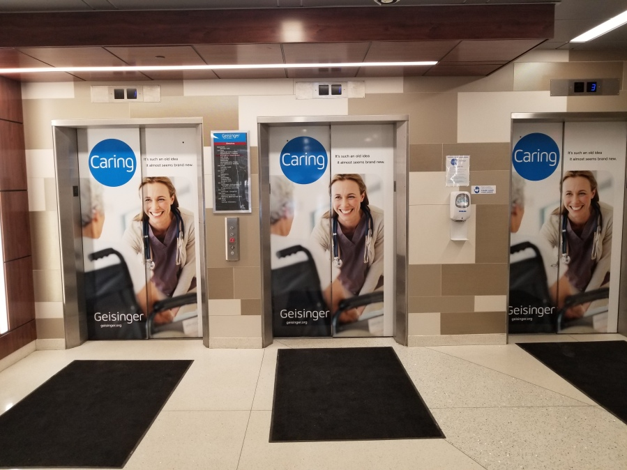 adhesive vinyl on elevator doors