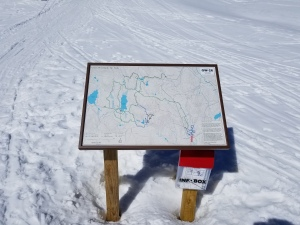 sign showing hiking trail maps